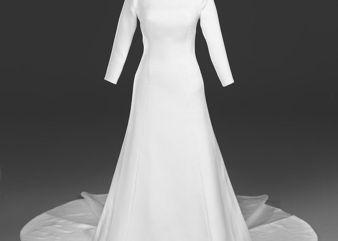 Meghan, Duchess of Sussex's wedding dress, as seen in the new Windsor Castle exhibit A Royal Wedding: The Duke and Duchess of Sussex